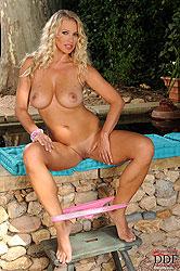 Hot busty blonde babe Nikita Valentin stripping outdoors