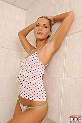Blonde babe Neilla posing her body & toying in bathroom